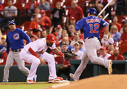 September 28, 2017 - St Louis, MO, USA - St. Louis Cardinals first baseman Jose Martinez is unable to catch the throw from pitcher Matt Bowman as the Chicago Cubs' Kyle Schwarber (12) reaches safely, then advances to second on the error, in the 11th inning on Thursday, Sept. 28, 2017, at Busch Stadium in St. Louis. The Cubs won, 2-1, as Schwarber scored the go-ahead run. (Credit Image: © Chris Lee/TNS via ZUMA Wire)