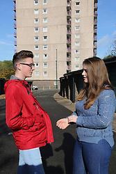 Teenagers chatting near flats