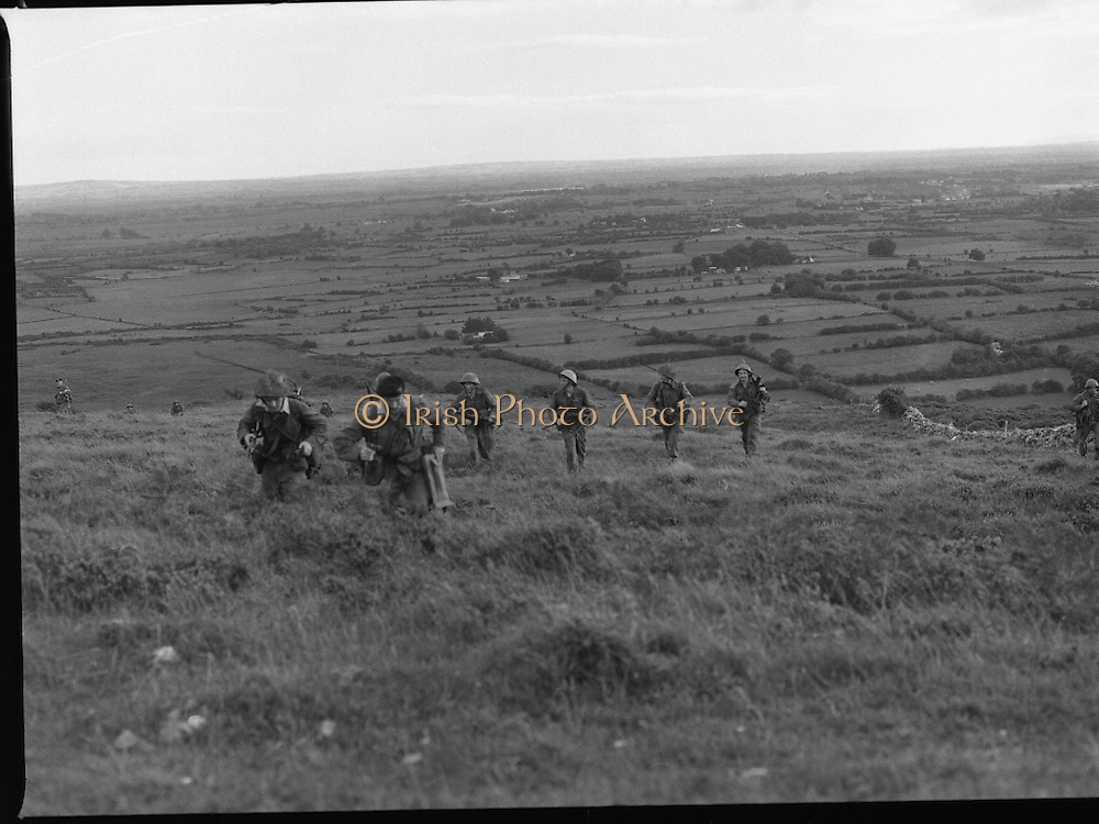 "Army Exercises In Co Sligo.   (L37).<br /> 1977.<br /> 05.09.1977.<br /> 09.05.1977.<br /> 5th September 1977.<br /> The Army Reserve Brigade, which is made up of regular units from the Southern Command, are conducting a series of conventional military exercises in counties Mayo and Sligo from the 5th to the 9th September. Approximately 1,500 men and 250 vehicles are involved. The exercise was codenamed ""Humbert"" after an ill fated expedition by French troops into Ireland on 23rd August 1798. 1,100 French troops with Irish support took on the incumbent English forces. After some initial success they were defeated at Ballinamuk on 8th Sept 1798 by the army of Cornwallis.<br /> <br /> Soldiers are pictured advancing up the hillside in attack formation."