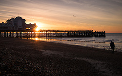 © Licensed to London News Pictures. 03/10/2016. Southsea, Hampshire, UK.  A photographer takes pictures on the beach as the sun rises over South Parade Pier in Southsea this morning, 3rd October 2016. People out enjoying the sunrise enjoyed a cool but clear morning on what is to be another dry and sunny autumn day in the south of England. Photo credit: Rob Arnold/LNP