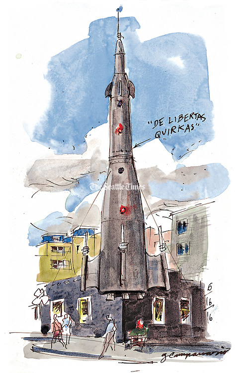 """This five-story rocket sits on the corner of Evanston Avenue North and North 35th Street in Seattle's Fremont neighborhood. A piece of fuselage repurposed from a military aircraft forms the whimsical spaceship. It comes with a mission: """"De Libertas Quirkas — Freedom to Be Peculiar. (Gabriel Campanario / The Seattle Times)"""
