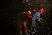 Men extract coal from an informal mine in Nalaikh, a poor urban district 36 km east of the capital Ulaanbaatar, Mongolia, January 16, 2019. Miners crawl in the darkness for hundreds of meters through narrow, unsafe passages before reaching the coal to be extracted.