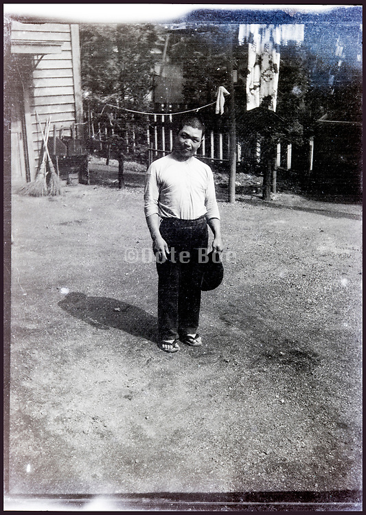 man posing in a bare backyard Japan ca 1940s