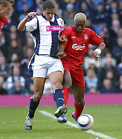 Photo: Dave Linney.<br />West Bromwich Albion v Liverpool. The Barclays Premiership. 01/04/2006 West Brom's .Curtis Davis(L) challeges for the ball with Cisse