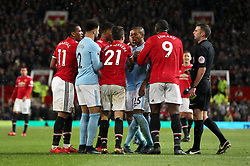 Playre react after Manchester United's Ander Herrera is shown the yellow card by referee Michael Oliver during the Premier League match at Old Trafford, Manchester.