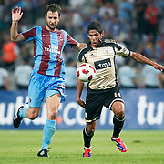 Trabzonspor's Remzi Giray KACAR (L) and Benfica's Franco JARA (R) during their UEFA Champions League third qualifying round, second leg, soccer match Trabzonspor between Benfica at the Ataturk Olimpiyat Stadium at İstanbul Turkey on Wednesday, 03 August 2011. Photo by TURKPIX