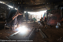 Visit to a welding shop on Day-7 of our Himalayan Heroes adventure riding from Tatopani to Pokhara, Nepal. Monday, November 12, 2018. Photography ©2018 Michael Lichter.
