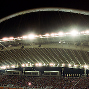 A panoramic view of a pole vaulter in action during the Athens 2004 Summer Olympic Games at the Olympic Stadium. Athens, Greece. 25th August 2004. Photo Tim Clayton.