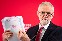 © Licensed to London News Pictures. 27/11/2019. London, UK. Labour Party Leader Jeremy Corbyn holds a copy of an unredacted report on trade negotiations with the USA at an event in Westminster. The report allegedly includes the NHS. Photo credit: Rob Pinney/LNP