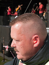 Earplugs being worn by security guard to protect them from loud noise at WOMAD 2009 music festival