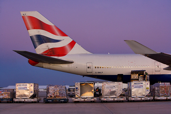 Cargo containers lined up for loading to a British Airways airliner