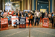 """11 JANUARY 2021 - DES MOINES, IOWA: A speaker talks about freedom and mask mandates in the Rotunda of the Iowa State Capitol in Des Moines. Hundreds of Iowans from across the state came to the State Capitol to protest the Governor's COVID-19 mitigation efforts. The Coronavirus (SARS-CoV-2) mitigation guidelines include a mask mandate indoors when it isn't possible to social distance. But the Governor specifically exempted the State Capitol. No one in the crowd wore a mask and there was no effort to follow """"social distancing"""" guidelines. There were also """"anti-Vaxxers"""" in the crowd who protested the vaccine efforts and said vaccines were unsafe.           PHOTO BY JACK KURTZ"""