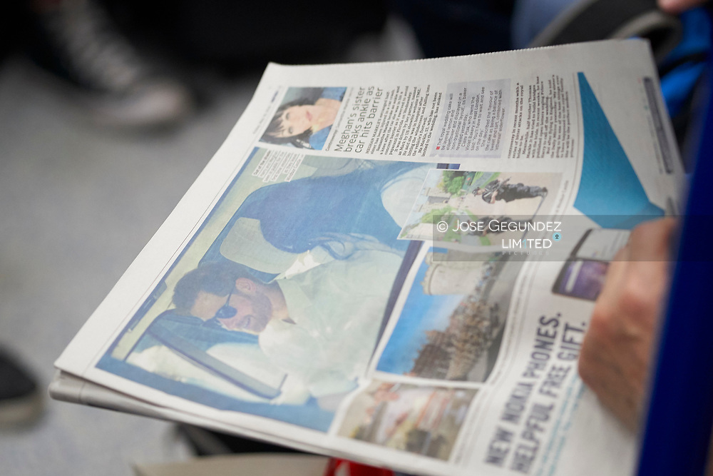 People reding a newspaper with Royal News the day before the Royal Wedding of Prince Harry and Meghan Markle on May 18, 2018 in London, , United Kingdom