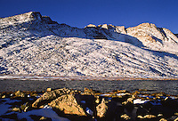 First snow of the autumn season on 14,264 ft. Mount Evans and Summit Lake. Front Range Mountains, Colorado.