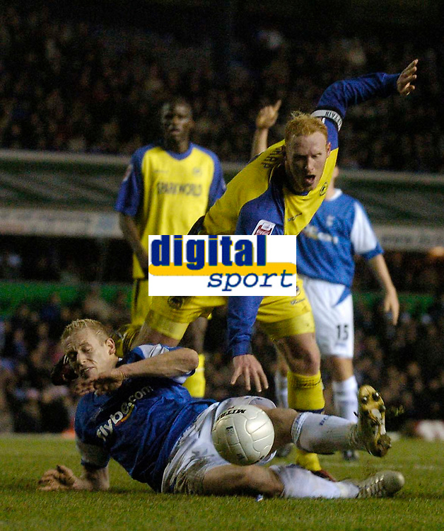 Photo: Glyn Thomas.<br />Birmingham City v Torquay United. The FA Cup. 17/01/2006.<br />Birmingham's Mikael Forssell (L) tangles with Torquay's Adam Lockwood in the penalty area, but no foul is awarded.