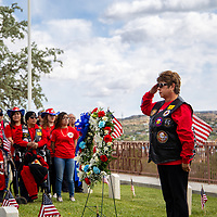 Navy veteran City Councilor Fran Palochak becomes emotional as she salutes the flag as she places the wreath at the Unknown Soldiers graves for Memorial Day on May 27, 2019 in Gallup.