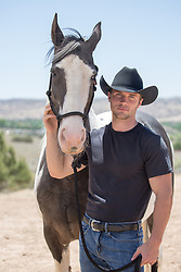 hot cowboy with a painted horse on a ranch