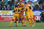 The Newport County players celebrate their 3rd goal scored by Andy Sandell (13) during the Skybet football league two match, Newport county v Chesterfield at Rodney Parade in Newport, South Wales on Sunday 1st Dec 2013. pic by Jeff Thomas, Andrew Orchard sports photography,