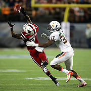 Louisville Cardinals wide receiver Damian Copeland (7) attempts a reception against Miami Hurricanes defensive back Ladarius Gunter (37) is seen during the NCAA Football Russell Athletic Bowl football game between the Louisville Cardinals and the Miami Hurricanes, at the Florida Citrus Bowl on Saturday, December 28, 2013 in Orlando, Florida. (AP Photo/Alex Menendez)