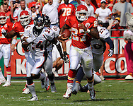 Running back Larry Johnson #27 of the Kansas City Chiefs rushes past the Denver Broncos defense for 65-yards in the first quarter at Arrowhead Stadium in Kansas City, Missouri on September 28, 2008.....