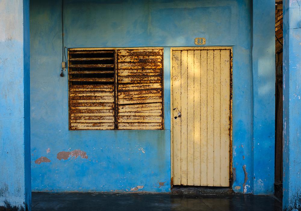 BARACOA, CUBA - CIRCA JANUARY 2020: Typical colorful home on the streets of Baracoa