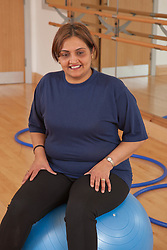 Woman doing exercise class. (NOT to be portrayed as Muslim)