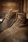 Close-up of pair of old leather boots inside Berghof Lodge in Bariloche, Argentina