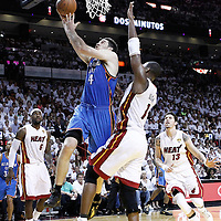 19 June 2012: Oklahoma City Thunder power forward Nick Collison (4) goes for the layup past Miami Heat power forward Chris Bosh (1) during the Miami Heat 104-98 victory over the Oklahoma City Thunder, in Game 4 of the 2012 NBA Finals, at the AmericanAirlinesArena, Miami, Florida, USA.