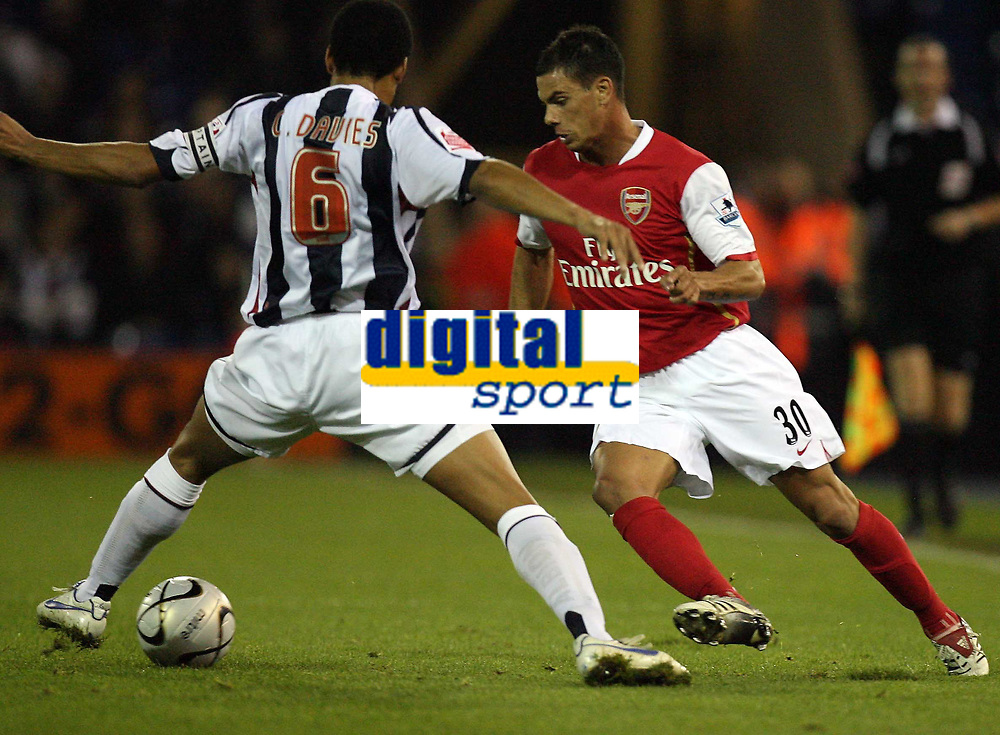 Photo: Rich Eaton.<br /> <br /> West Bromwich Albion v Arsenal. Carling Cup. 24/10/2006. Jeremie Aliadiere of Arsenal right takes on West Brom captain Curtis Davies