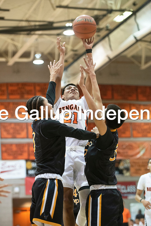 Gallup's Jeffery Yazzie (21) takes a jump shot against Navajo Prep Thursday, Jan. 2 at the Gallup Invitational boys basketball tournament at Gallup High School.