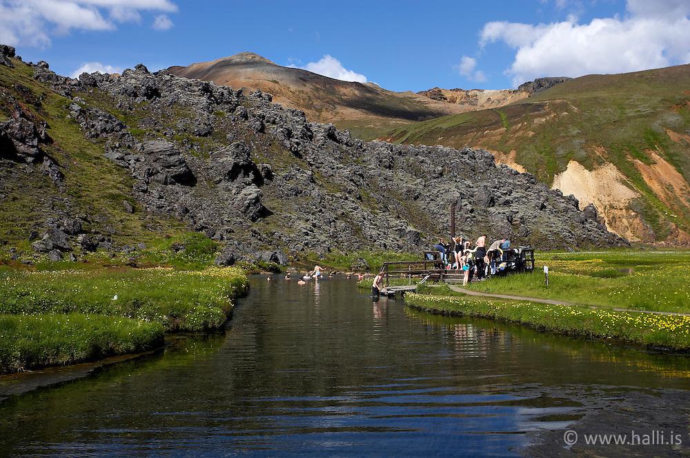 Tourists taking bath in warm water in Landmannalaugar, Iceland - Ferðamenn baða sig í heitum læk í Landmannalaugum