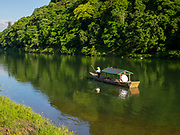 Traditional tourist boat on the Katsura River in Arashiyama, Kyoto, Japan