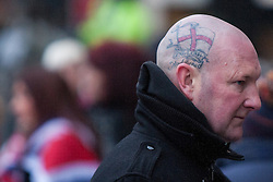 "© Licensed to London News Pictures . 19/01/2013 . Manchester , UK . A man with a tattoo on his head that reads ""English and proud "" attends the demonstration . Loyalist protesters demonstrate outside Manchester Town Hall in the city's Albert Square , today (19th January 2013) . Photo credit : Joel Goodman/LNP"