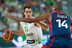 Domen Lorbek of Slovenia and Alexis Ajinca of France during friendly match between National teams of Slovenia and France for Eurobasket 2013 on August 31, 2013 in Arena Stozice, Ljubljana, Slovenia. (Photo by Matic Klansek Velej / Sportida.com)