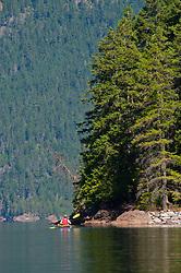 Joe Paddling on Ross Lake, Ross Lake National Recreation Area, North Cascades National Park, Washington, US