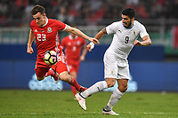 """Luis Suarez, right, of Uruguay national football team kicks the ball to make a pass against Tom Lockyer of Wales national football team in their final match during the 2018 Gree China Cup International Football Championship in Nanning city, south China's Guangxi Zhuang Autonomous Region, 26 March 2018.<br /> <br /> Edinson Cavani's goal in the second half helped Uruguay beat Wales to claim the title of the second edition of China Cup International Football Championship here on Monday (26 March 2018). """"It was a tough match. I'm very satisfied with the result and I think that we can even get better if we didn't suffer from jet lag or injuries. I think the result was very satisfactory,"""" said Uruguay coach Oscar Tabarez. Wales were buoyed by a 6-0 victory over China while Uruguay were fresh from a 2-0 win over the Czech Republic. Uruguay almost took a dream start just 3 minutes into the game as Luis Suarez's shot on Nahitan Nandez cross smacked the upright. Uruguay were dealt a blow on 8 minutes when Jose Gimenez was injured in a challenge and was replaced by Sebastian Coates. Inter Milan's midfielder Matias Vecino of Uruguay also fired at the edge of box from a looped pass but only saw his attempt whistle past the post. Suarez squandered a golden opportunity on 32 minutes when Ashley Williams's wayward backpass sent him clear, but the Barca hitman rattled the woodwork again with goalkeeper Wayne Hennessey well beaten."""
