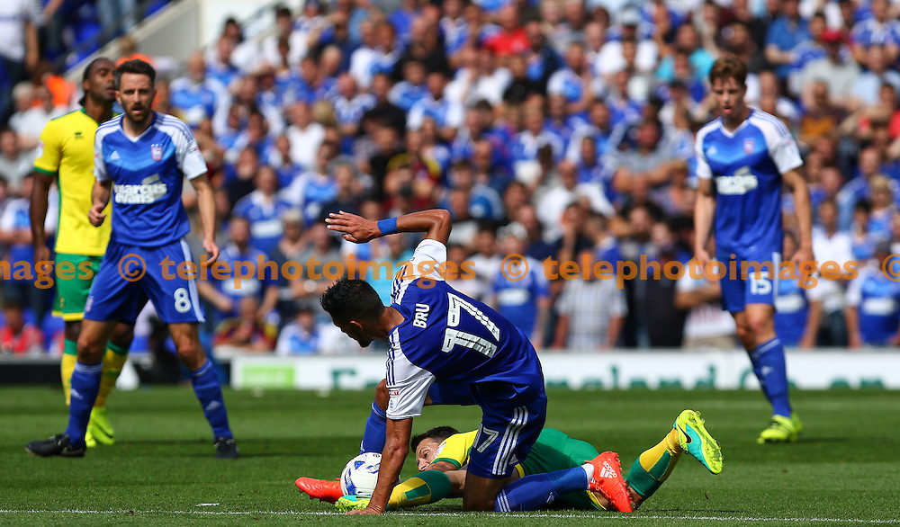 Kevin Bru of Ipswich Town tackles Wesley Hoolahan of Norwich City during the Sky Bet Championship match between Ipswich Town and Norwich City at Portman Road in Ipswich. August 21, 2016.<br /> Arron Gent / Telephoto Images<br /> +44 7967 642437