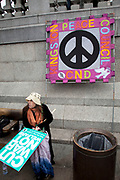 """CND banner. Protest in central London to mark 10 years of the conflict in Afghanistan. Musicians, actors, film-makers and MPs are joining protesters for the Anti-war Mass Assembly in Trafalgar Square. The Stop The War Coalition said up to 5,000 people were at the protest but a BBC correspondent estimated there were about 1,000 people in the square. The coalition says opinion polls show most British people want a """"speedy withdrawal"""" of UK forces. The demo brought together people from many groups in solidarity."""