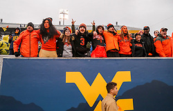 Nov 23, 2019; Morgantown, WV, USA; Oklahoma State Cowboys fans celebrate after defeating the West Virginia Mountaineers at Mountaineer Field at Milan Puskar Stadium. Mandatory Credit: Ben Queen-USA TODAY Sports