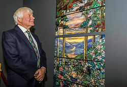 The Carnegie Tiffany Window, commissioned by Andrew Carnegie in 1913 as a memorial window for his parents has been installed in Dunfermline Abbey. The window was designed and made in the Tiffany Studios, New York<br /> <br /> Pictured: Great Grandson of Andrew Carnegie, William Thomson inspecting the window after the installation ceremony