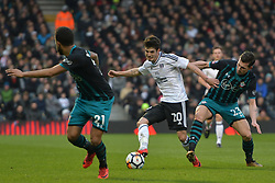 January 6, 2018 - Fulham, England, United Kingdom - Southampton's Pierre-Emile Hjbjerg  jostles with Fulham forward Lucas Piazon during the FA Cup 3rd Round match between Fulham against Southampton  at Craven Cottage Stadium, London England on 06 Jan 2018. (Credit Image: © Kieran Galvin/NurPhoto via ZUMA Press)
