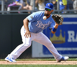 August 20, 2017 - Kansas City, MO, USA - Kansas City Royals third baseman Cheslor Cuthbert grabs a ground ball before throwing high to first for an error, allowing Cleveland Indians' Yan Gomes to reach first in the seventh inning on Sunday, Aug. 20, 2017 at Kauffman Stadium in Kansas City, Mo. (Credit Image: © John Sleezer/TNS via ZUMA Wire)