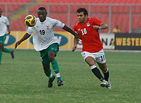 Photo: Steve Bond/Richard Lane Photography.<br />Egypt v Zambia. Africa Cup of Nations. 30/01/2008. Emad Motaeb (R) closes down Clive Hachilensa (L)