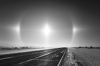 We were heading out of the city to the south on Hwy 2 when we saw this Sun Dog form in the ice fog and blowing snow. We were able to see it for well over an hour as we drove through the prairie landscape and it was an amazing sight to see!<br /> <br /> ©2014, Sean Phillips<br /> http://www.RiverwoodPhotography.com