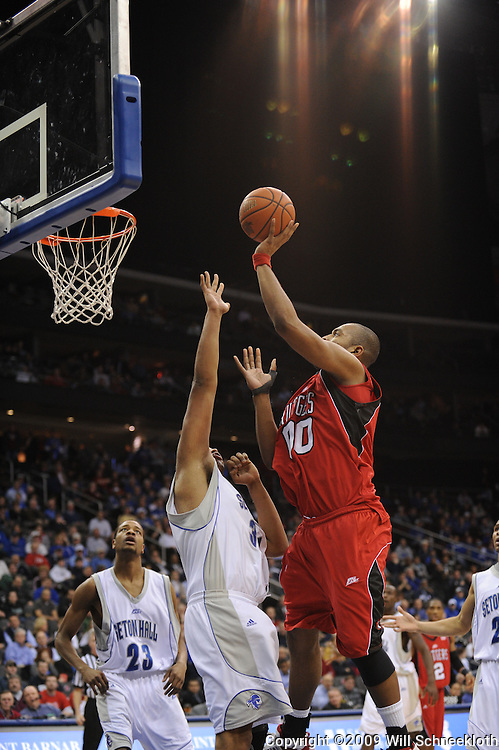 Jan 29, 2009; Newark, NJ, USA;  Rutgers forward Gregory Echenique (00) puts up a shot over Seton Hall forward/center John Garcia (31) during the second half of Seton Hall's 70-67 victory at the Prudential Center.
