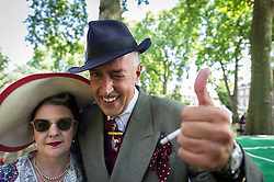 Viv the Spiv and his partner at the Chap Olympiad. 2014. An annual event celebrating Britain's sporting ineptitude. Bedford Square, London
