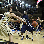 Central Florida guard Taylor Young (12) inbounds the ball to Central Florida forward P.J. Gaynor (21) during a Conference USA NCAA basketball game between the Rice Owls and the Central Florida Knights at the UCF Arena on January 22, 2011 in Orlando, Florida. Rice won the game 57-50 and extended the Knights losing streak to 4 games.  (AP Photo/Alex Menendez)