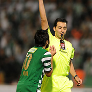 Referee's Abdullah YILMAZ show the yellow card to Bursaspor's Volkan SEN (L) during their Turkish soccer super league match Bursaspor between Kayserispor at Ataturk Stadium in Bursa Turkey on Saturday, 01 May 2010. Photo by TURKPIX