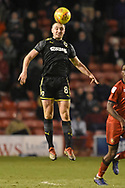 AFC Wimbledon midfielder Anthony Hartigan (8) wins the ball during the EFL Sky Bet League 1 match between Walsall and AFC Wimbledon at the Banks's Stadium, Walsall, England on 12 February 2019.
