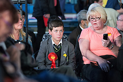 © Licensed to London News Pictures . 12/05/2014 . Manchester , UK . A boy wearing a Labour rosette sitting in the audience as the leader of the Labour Party , Ed Miliband , delivers a speech on health at the National Squash Centre in Manchester today (Monday 12th May 2014) . Photo credit : Joel Goodman/LNP